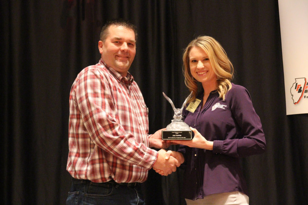 Presenting Joe Steffen (left) with the Illinois Cooperative Council's Outstanding Educator Award, is vice-chair Renee Deuth (right).